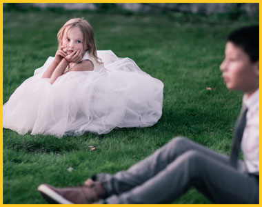 Image of young girl and boy on a lawn